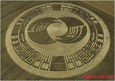 a crop circle near silbury hill in wiltshire england that resembles an aztec sun stone