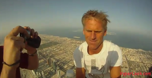 Guys Sitting On Top Of The Tallest Building In The World