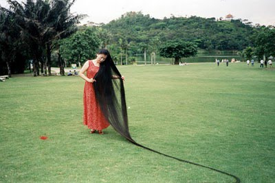Xie Qiuping 3 12 Year Old Girl With Longest Hair: 5 Feet 2 Inches Long as seen on CoolWeirdo.com
