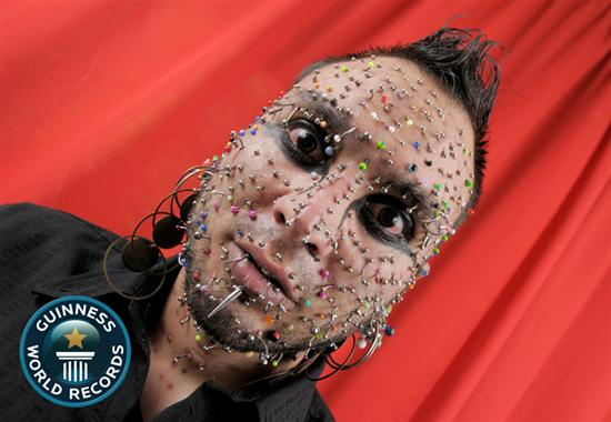 Axel Rosales Most Piercings On Face