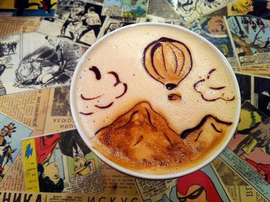mountains and baloon coffee foam art