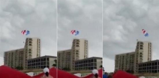 girls Parasailing slam into building 1