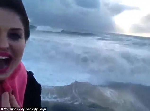 huge wave knocked the women off her feet