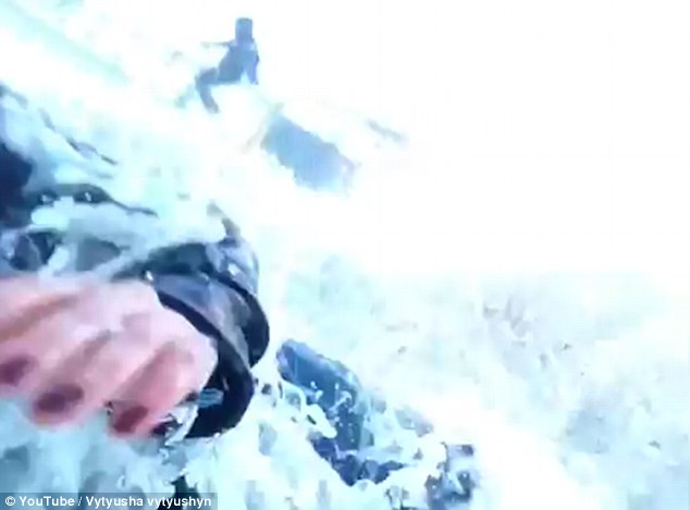 woman knocked down by a giant wave