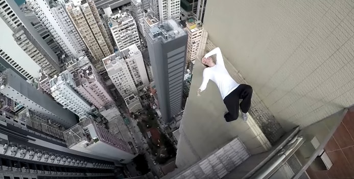 Russian Daredevil Oleg has released a new video – hanging from the edge of a skyscraper doing a morning workout