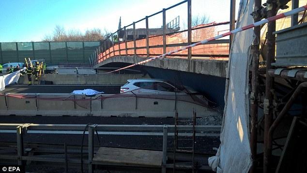 car under the collapsed bridge