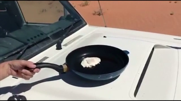 fried egg on a car bonnet