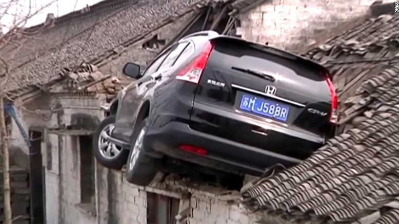 out of control SUV crush house roof