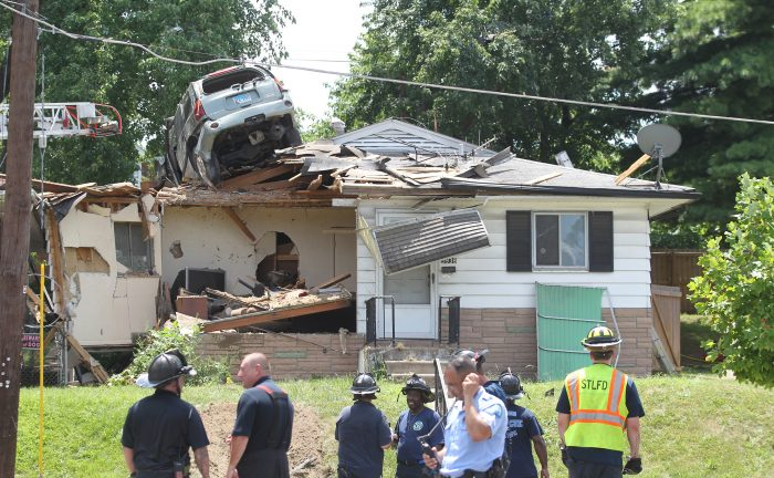 Car crashes onto roof of house in St. Louis